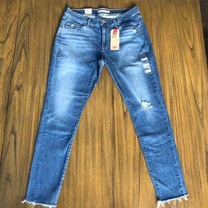 Levi's Curvy Skinny distressed raw hem jeans